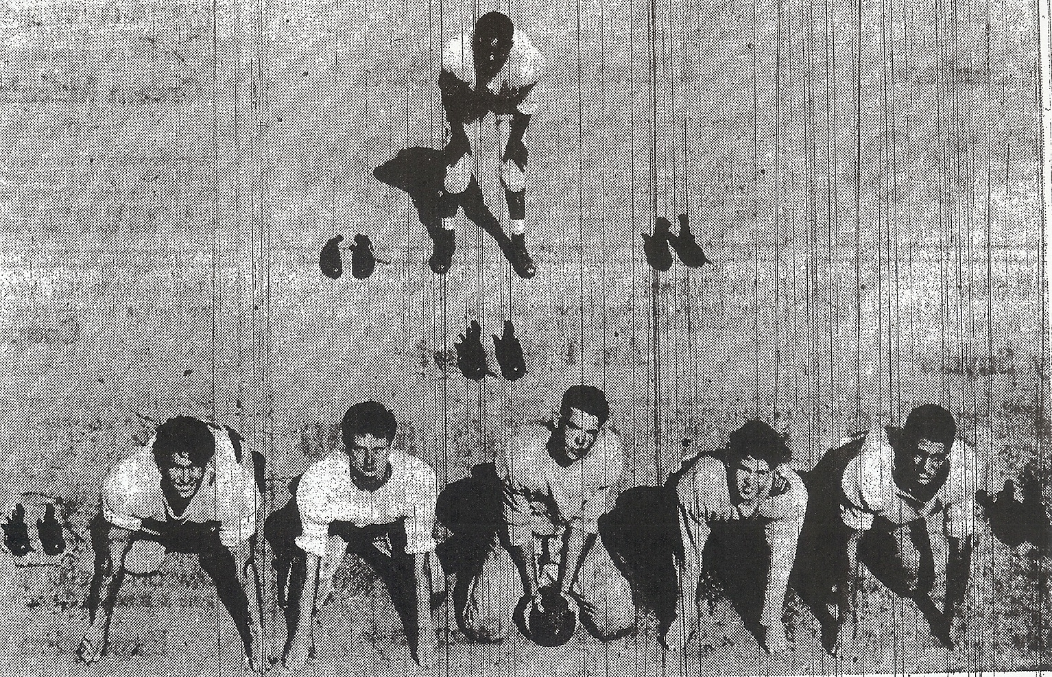 You guessed it. Empty shoes represent graduated players Sweetwater must replace. Line (from left), shoes, Bob Hansen, Bill mythe, Dan Griffin, Dave Rusk, Dave Oberlin, asnd another pair of shoes. Junior Booker is surrounded by footwear in backfield.