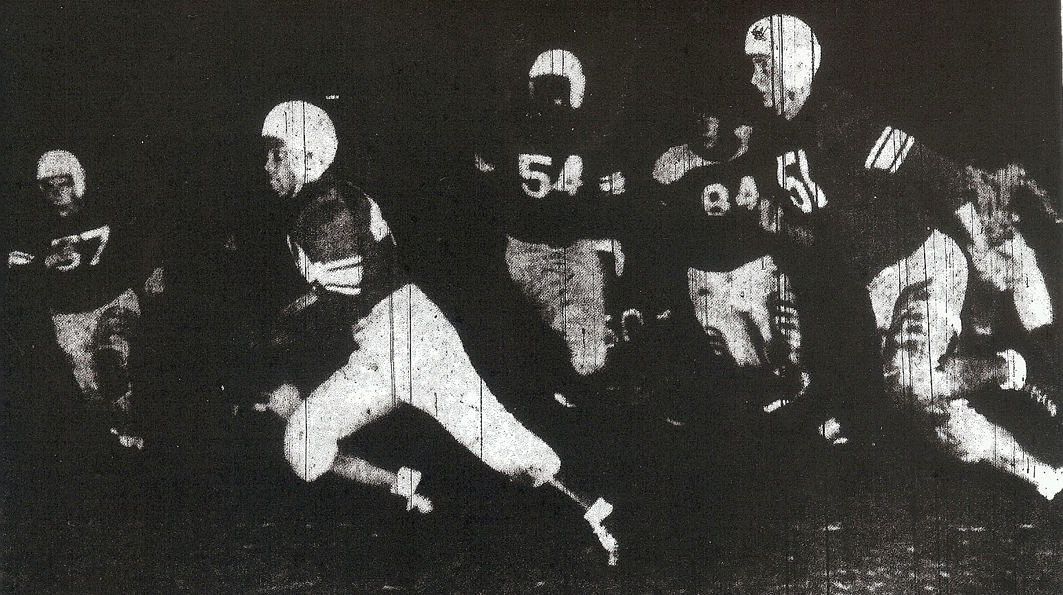 Ted Ritchey is in front of his convoy, Gen e Edwards (57), Ernie Smith (54), and Bob Conklin (51) as San Diego routed Hoover, 48-7.