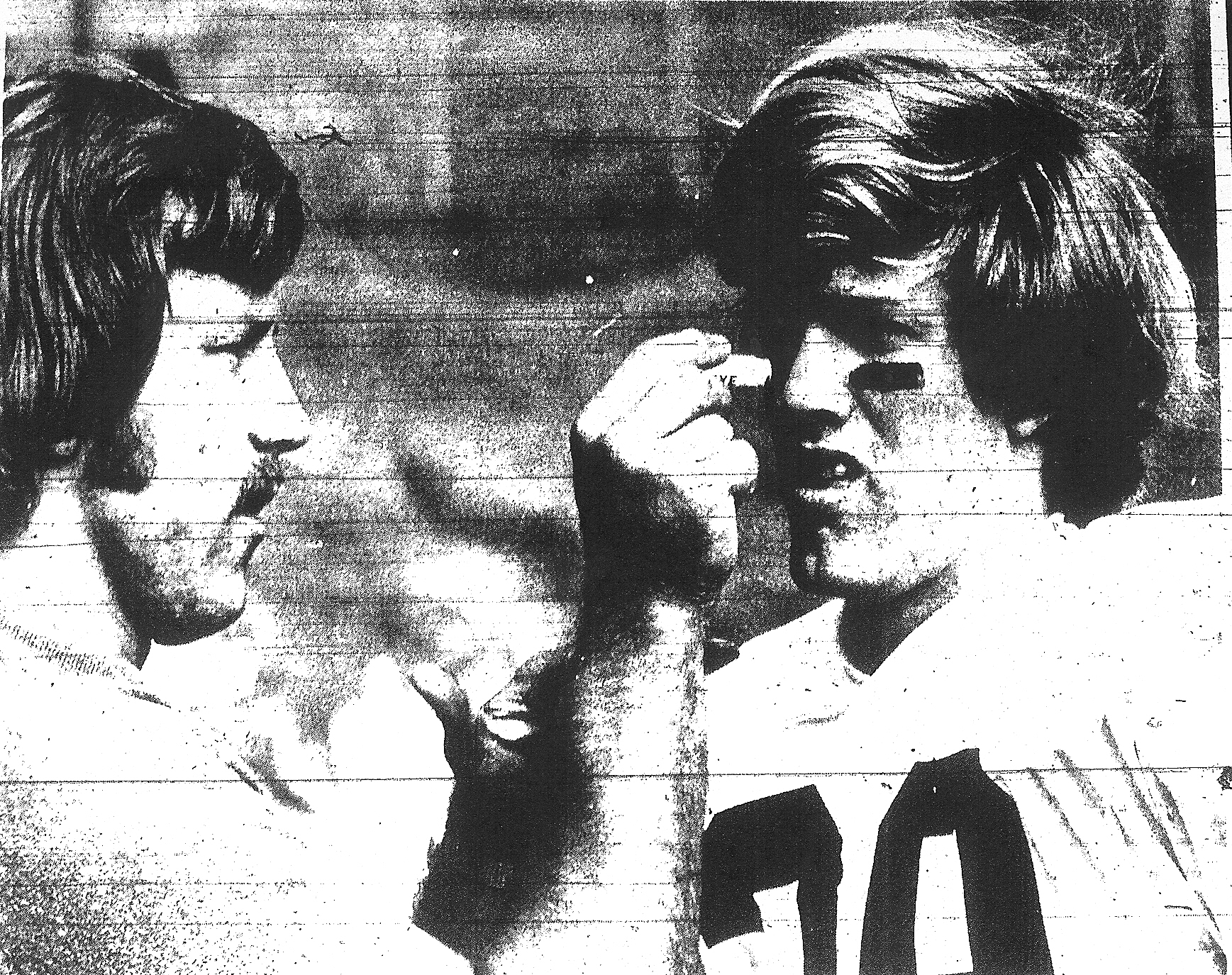 Patrick Henry assistant coach Garth DeFelice, a future NFL game officiating umpire, takes on quasi role of surgeon, removing dirt from the eye of defensive back Kirk Feldman, who just intercepted his third pass in second quarter of Patriots' 34-13 victory over St. Ajugustine.