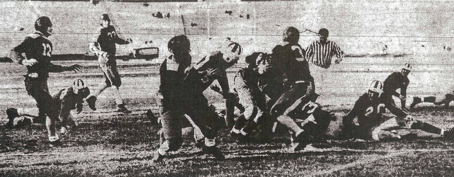 Sal Mena (striped helmet between two Hoover defenders) scored 2 touchdowns in San Diego victory.