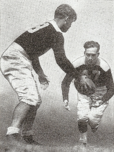 Greene handed off to teammate in 1934 Chicago Cardinals publicity photo.