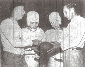 Escondido assistant Bob (Chick) Embrey, Bill Stewart, Larry Cope, and head coach Walt West (from left) inspect rubber ball.