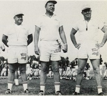Vinton (cnter) was joined at a 1967 practice with assistants Tom Feeser (left) and Bill White.