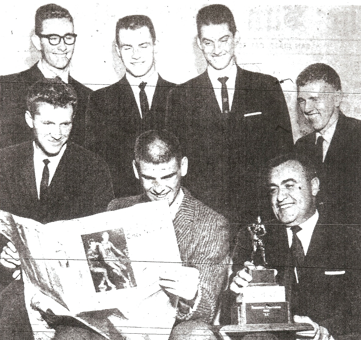 Winning Pointers, back row from left:  Larry Moore, Mike Dolphin, Dick Walden, Doug Lawrence.  Front: Winston Yetta, Don Sadas, reading newspaper account, and coach Hilbert Crosthwaite.