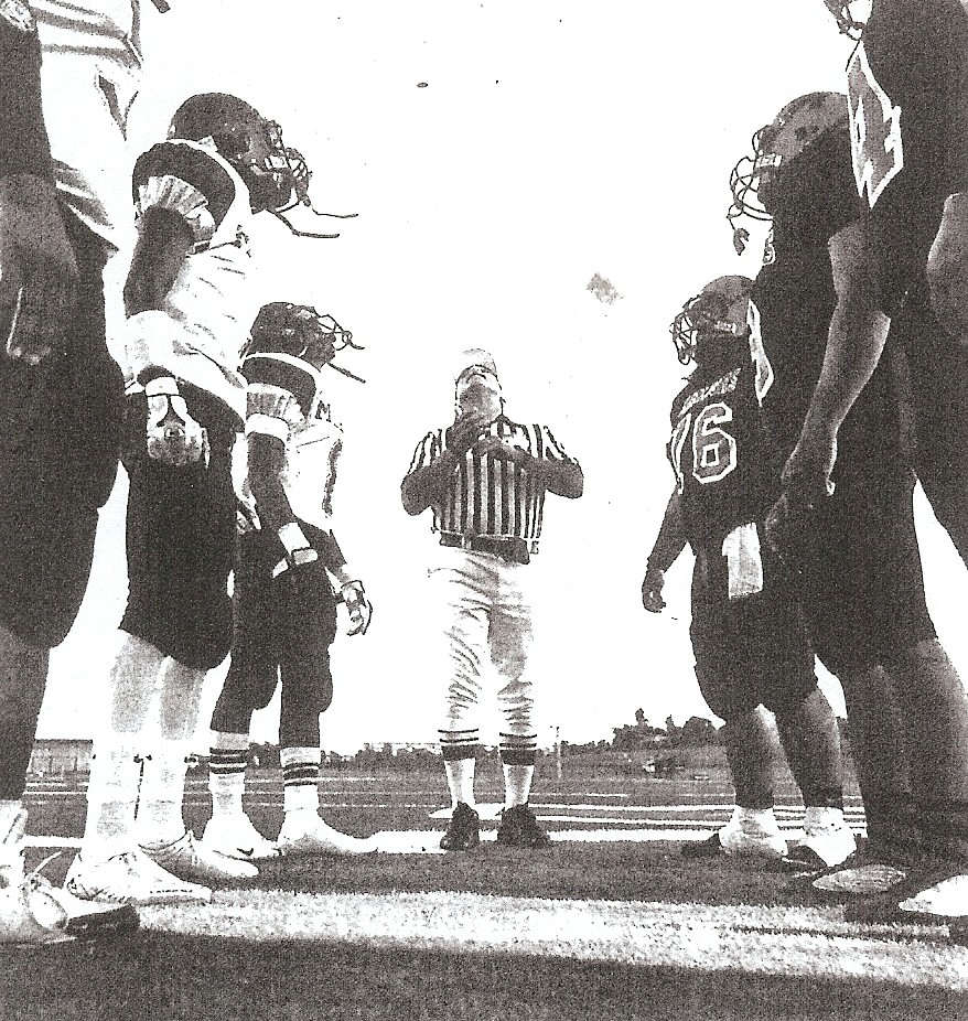 Referee Mike Parsa flips coin with historic implication at Morse-Mount Miguel game.