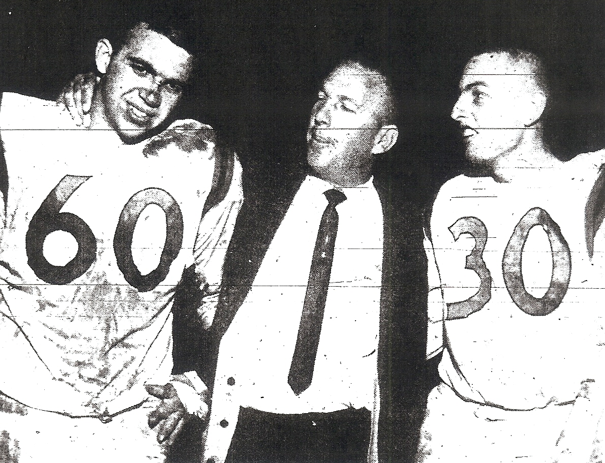 Embrey had a shout out for center Don Clothier (left), who snapped the ball and blocked for quarterback Doug Bennett (right).