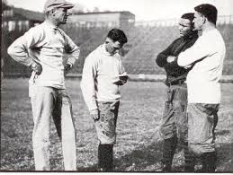 The 1922 Golden Bears' coaching staff. Nibs is second from left, next to Andy smith (left).