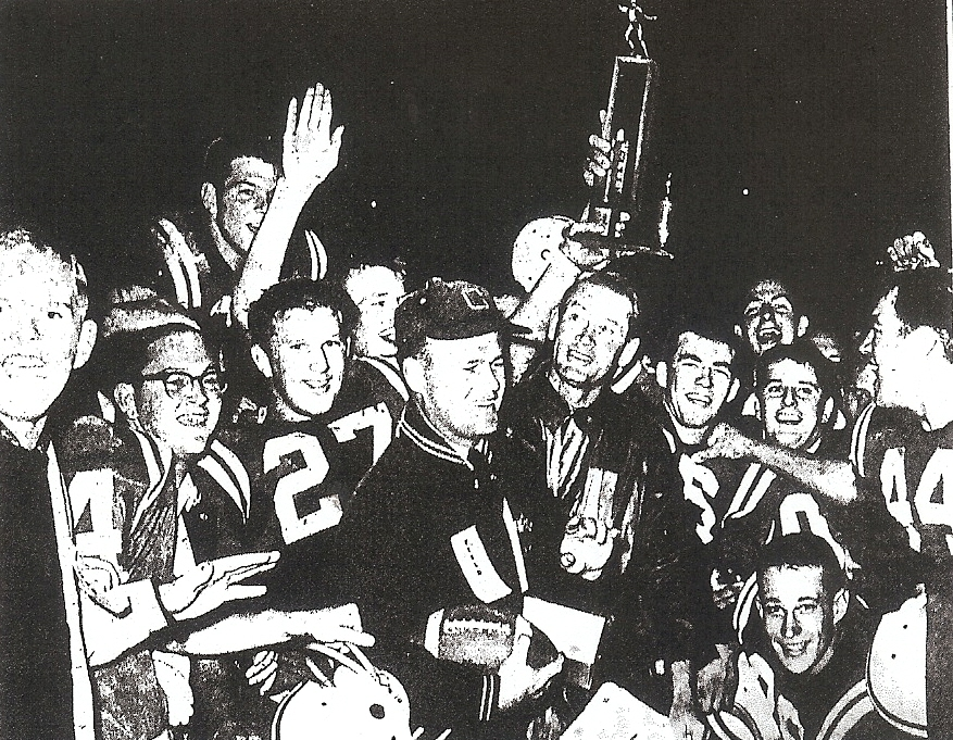 Coaches Frank Smith (left) and Walt Harvey were surrounded by winning Colts following 13-0 shutout of Kearny.