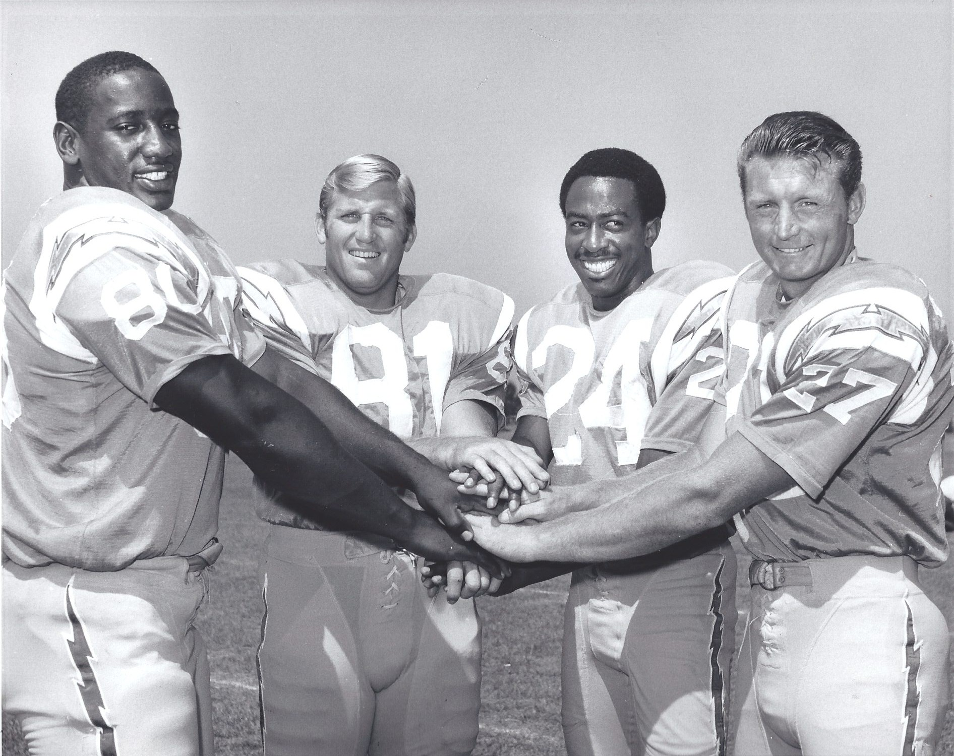 Staggs (second from left) and former San Diego State teammates Houston Ridge, Bobby Howard, and Gary Garrison (from left) were reunited with San Diego Chargers.