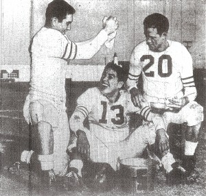 Quarterback Don Magee of Sweetwater enjoys impromptu water drop from Art Coltee and Don Lindsay (20)) in lighter moment before Chula Vista game,
