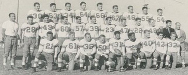 The 1943 Cardinals, Hoover's lone, undefeated squad. Head coach Raleigh Holt (left) was assisted by Bob Breitbard (dark top, second row).  Stars included Eddie Crain (31), Jim Morgan (25), Frank mith (40).