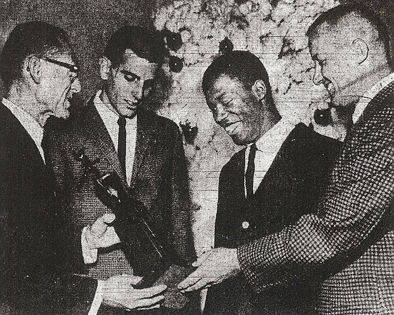 Kovac (right) and track coach Dick Coxe (left) honored track's Sterling Jenkins and football's Richard (Prime) McClendon at San Diego Junior College's 1963 fall sports awards banquet.