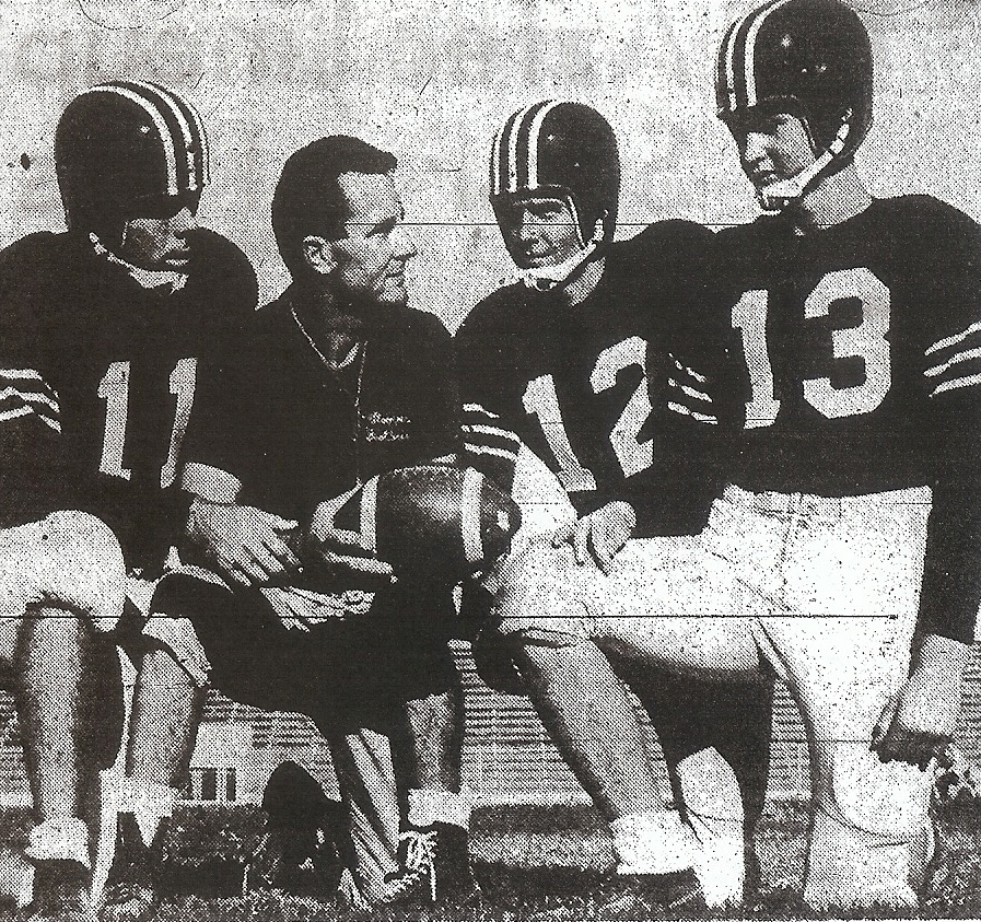 Hoover coach Roy Engle plotted season with quarterbacks Dick Verdon, Gary Bailey, and Dave Kusan (from left).