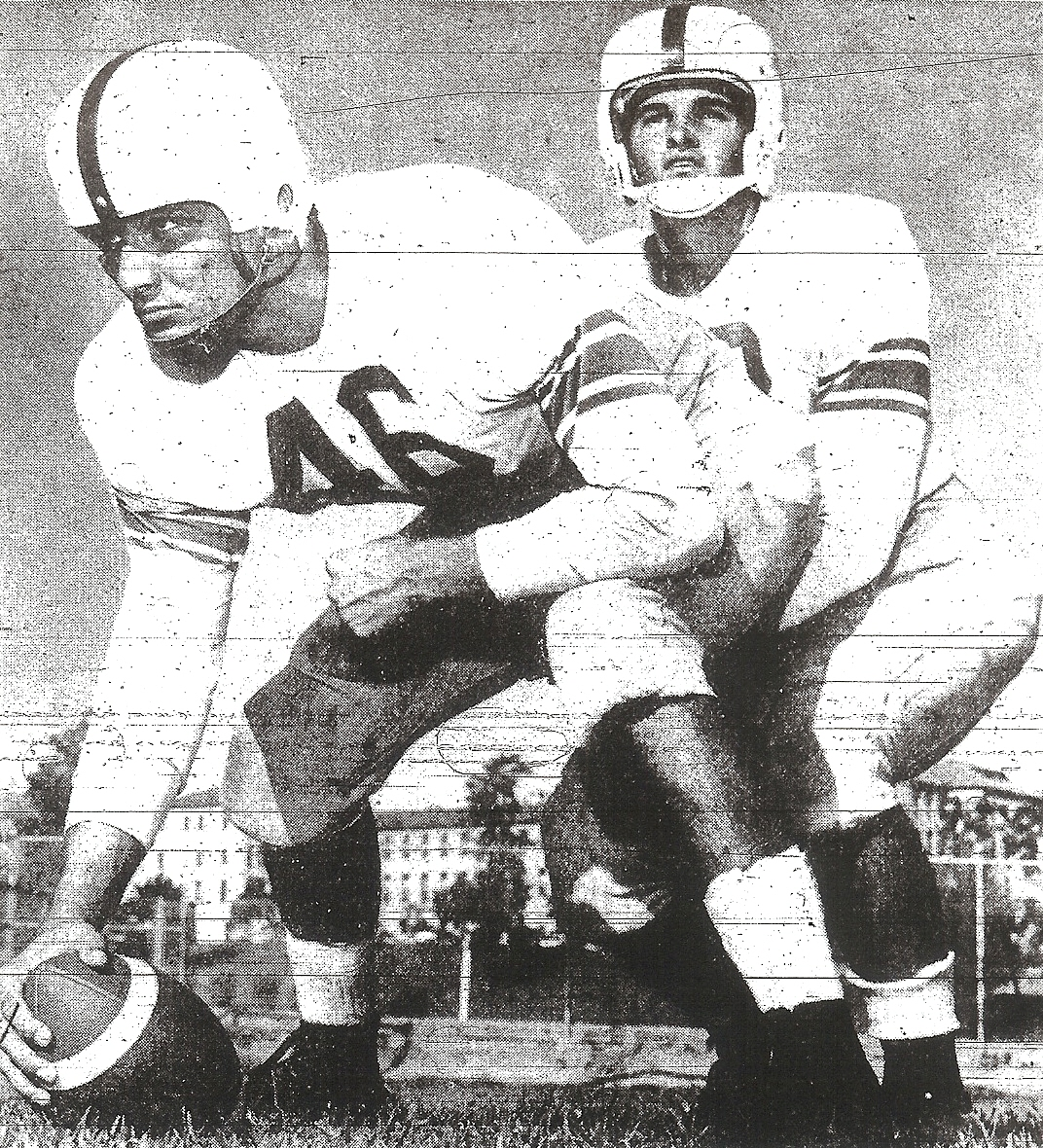 Center Ron Collins, with quarterback Dave Conger, was only returning offensive starter for San Diego Cavemen.