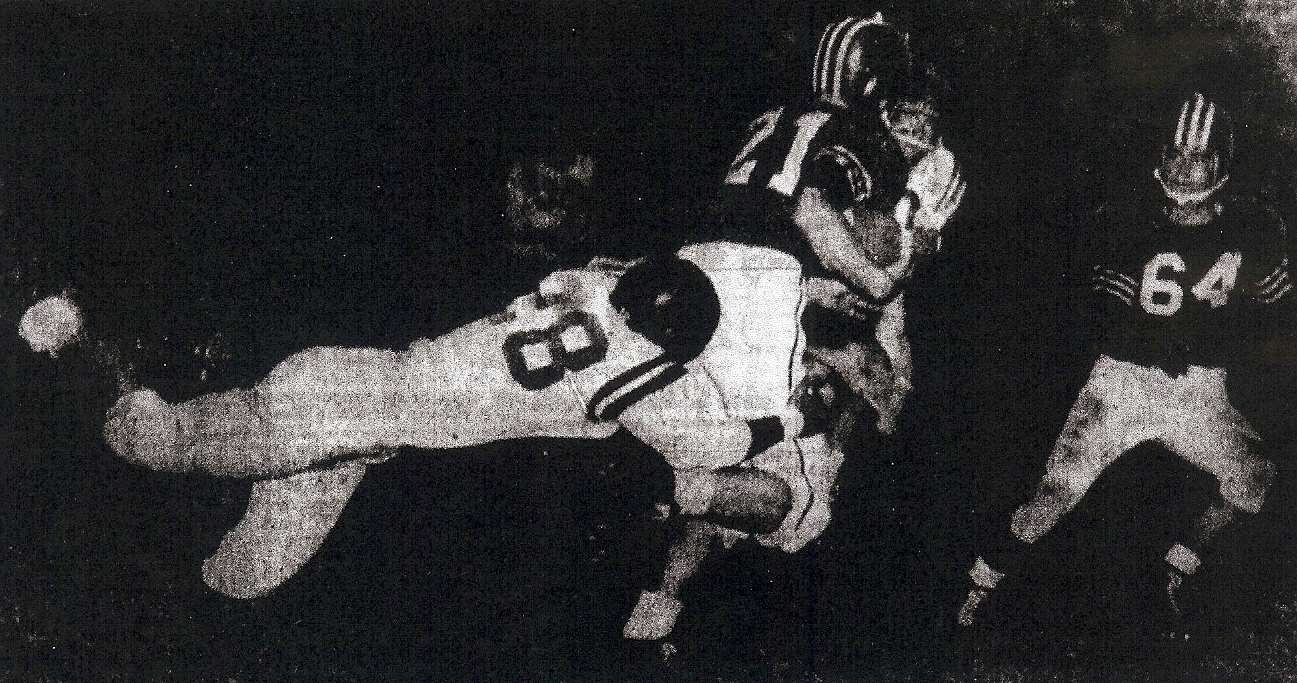 Helix was playing catch up with Hoover all night, as Cardinals' Bobby Ball gained 15 yards before tackle by Highlanders' Wayne Voight.  Hoover's 64 is Doug Dunnam.