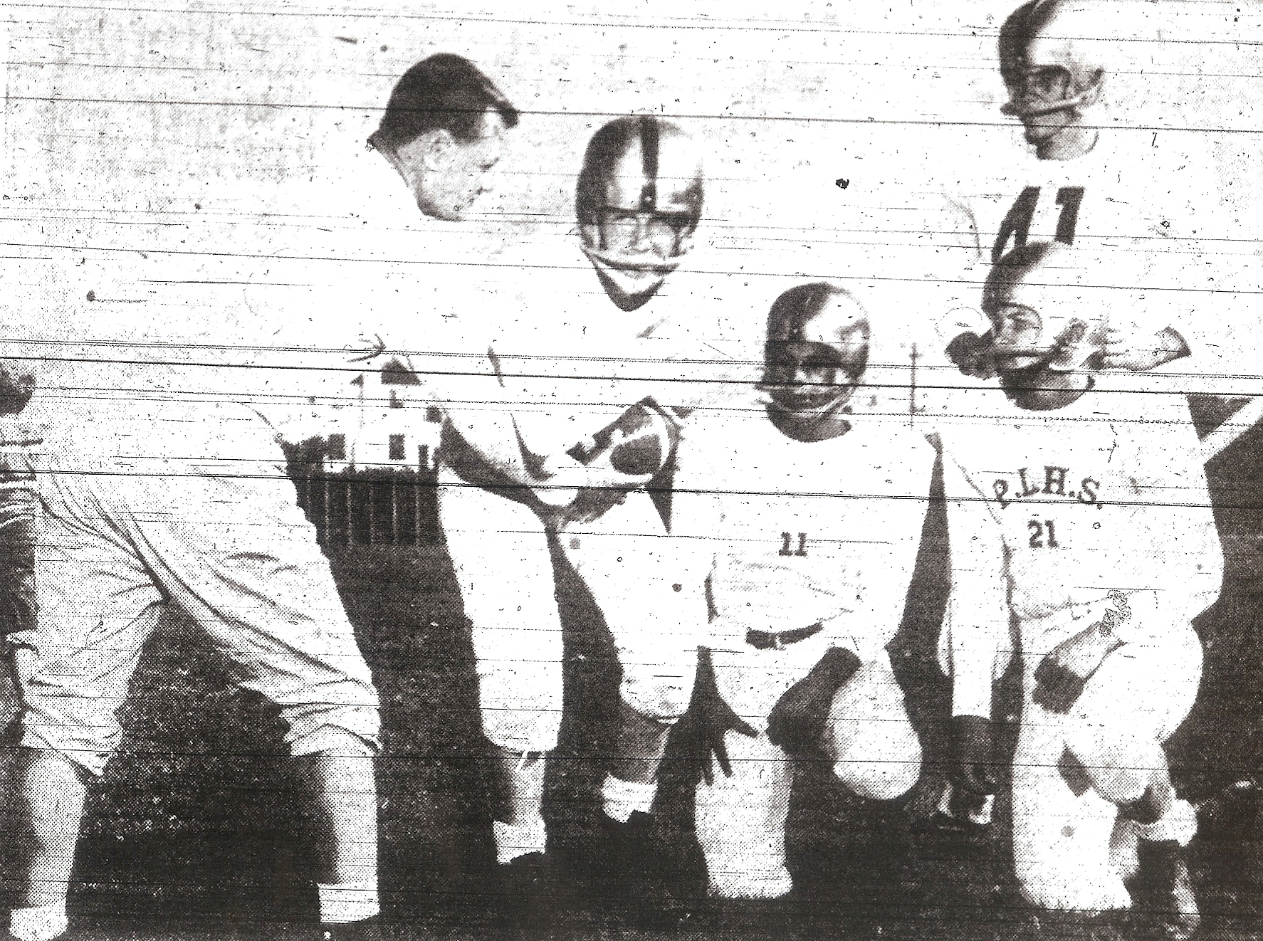 Bennie Edens coached the handoff better than he demonstrated for quarterbacks Doug Minton, Roger Soares, and Ray Hermans (kneeling, from left) and Jerry Booth.