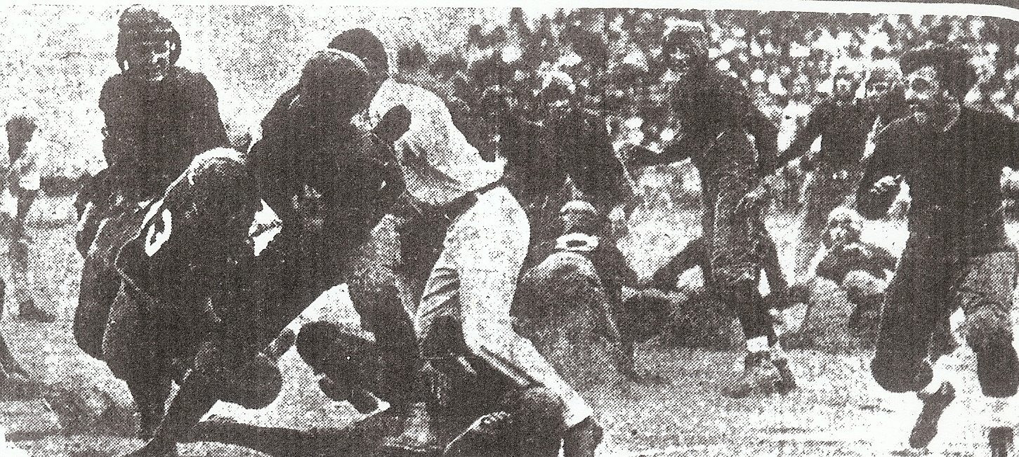 Pasadena appeared to have a 12th defender, the game umpire, as it attempted to stop San Diego fullback Bert Ritchey.
