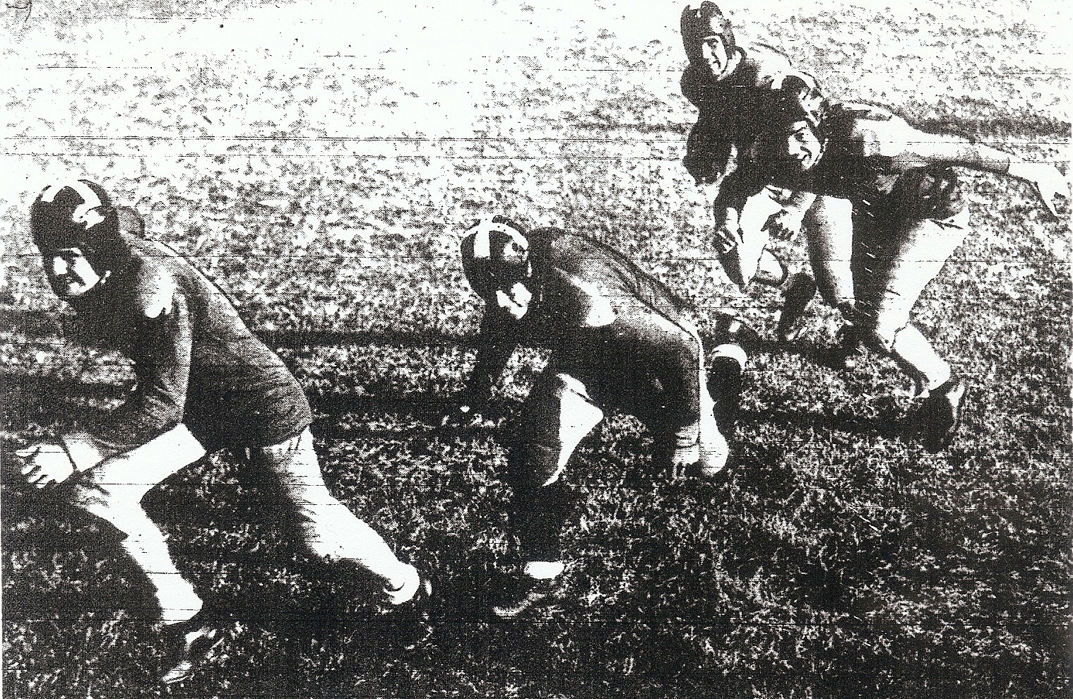 Trometter (left) was lead blocker for MCRD Devildogs and ball carrier Don Gibson (rear) in 1937.