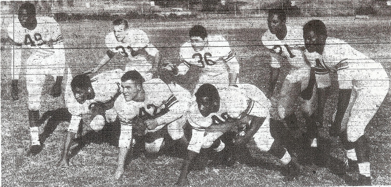 Edwards (right) and San Diego High teammates dominated on defense as well as offense.
