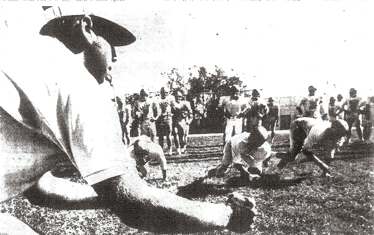 Shepard, conducting a line drill in practice at St. Augustine, remembered muddy field.