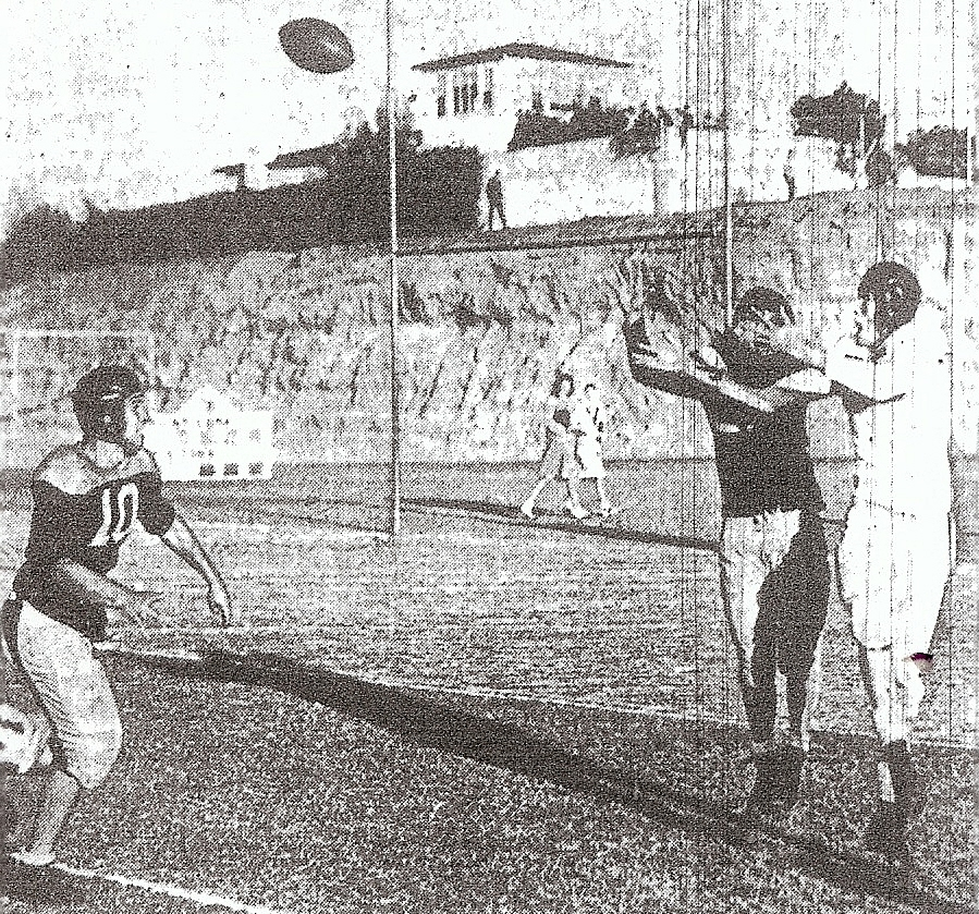What catches your eye? The pass intercepted by Point Loma against Kearny or the two coeds in background strolling into the game after kickoff. Yoto Takeshita picked the pass from Dick Pedrin to Bob Walke, while Point Loma's Pete Simmons (10) arrived to support Takeshita.