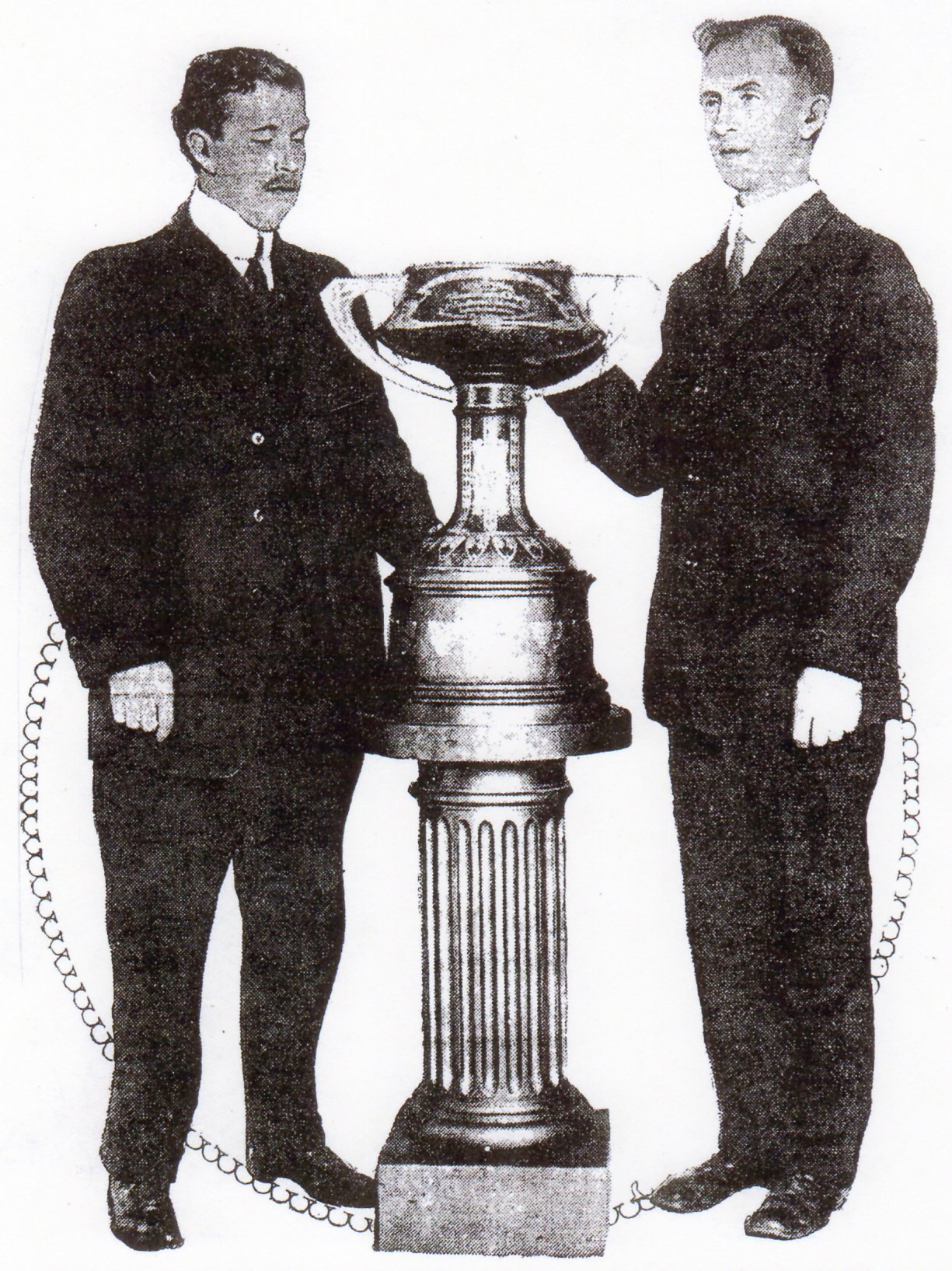 Van Patten (right) and Earnest Oliver of Los Angeles High, with perpetual trophy, were pivotal figures in formation of CIF kin 1913.