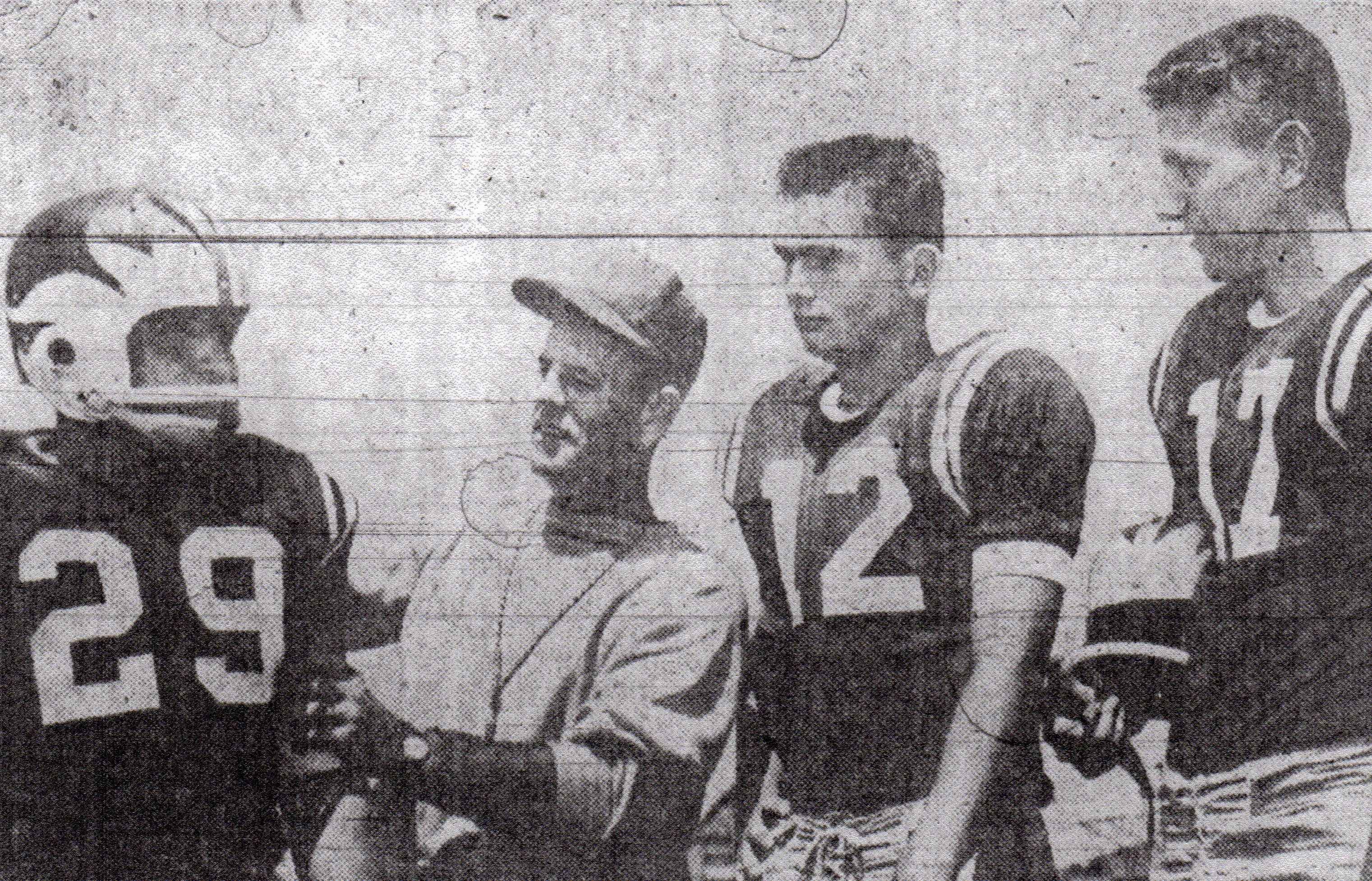 Coach Tom Parker sized up1958 season with Albert Belmontez, Leslie Pearson, and Wayne Sevier (from left).